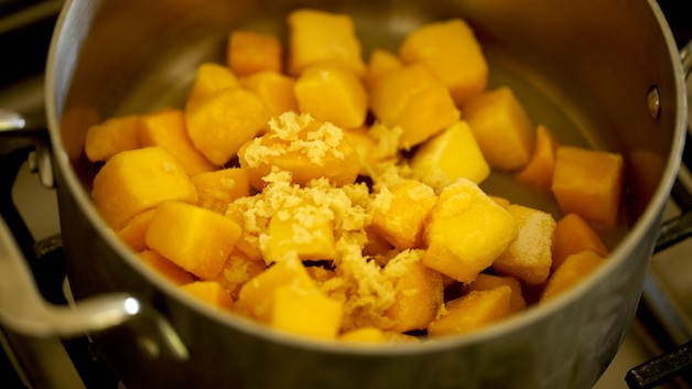 Frozen Mangos and grated ginger in a pot