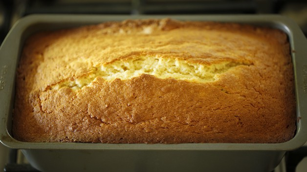 Coconut pound cake in a loaf pan cooling