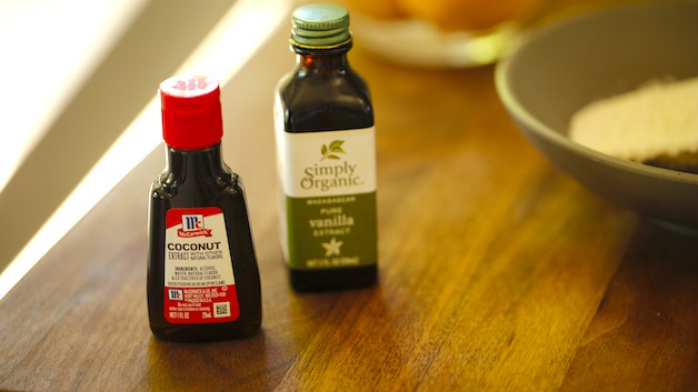 Coconut Extract and vanilla extract bottles on a cutting board