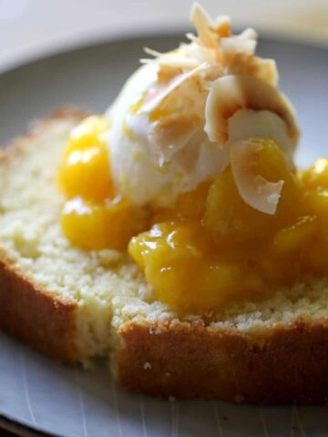 Vanilla Ice Cream and Mango Sauce with Coconut Flakes on top of a slice of coconut pound cake