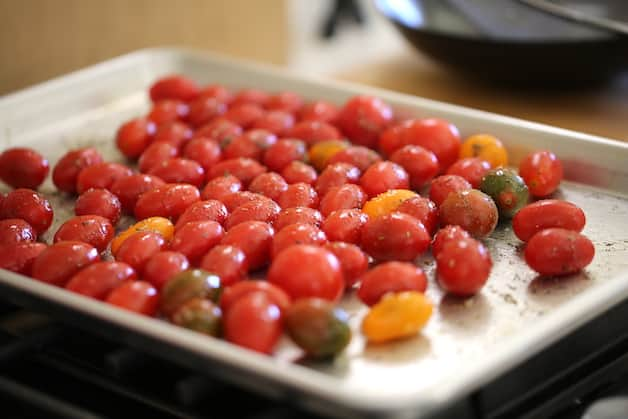 cherry tomatoes on a sheet pan