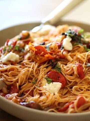 Angel Hair Pasta and Mozzarela and Basil in a large bowl