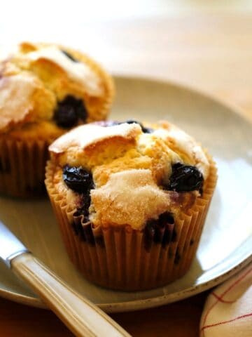 Blueberry Muffins on a plate with a red and white checked napkin