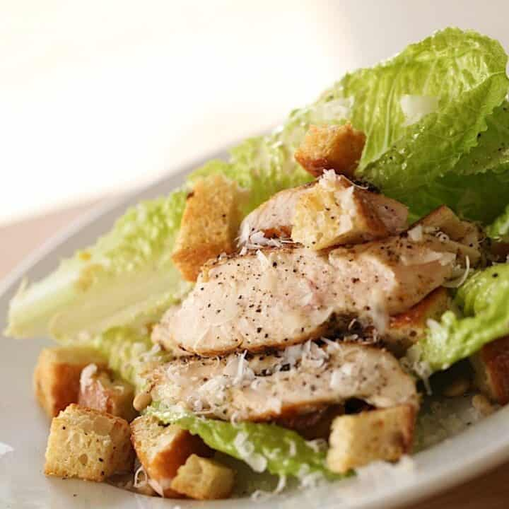 A Caesar Salad with Grilled Chicken on a Plate