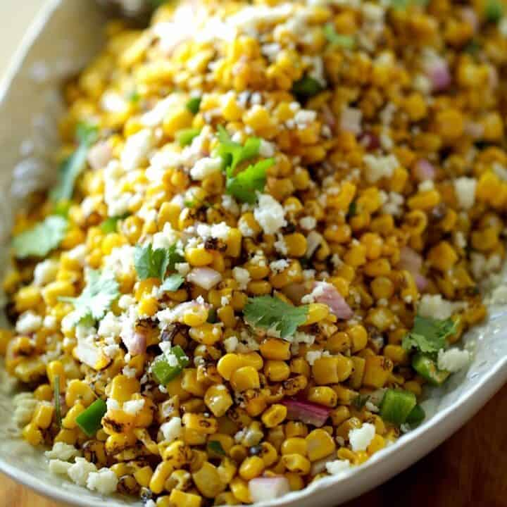 Corn Salad on a platter with cheese and cilantro
