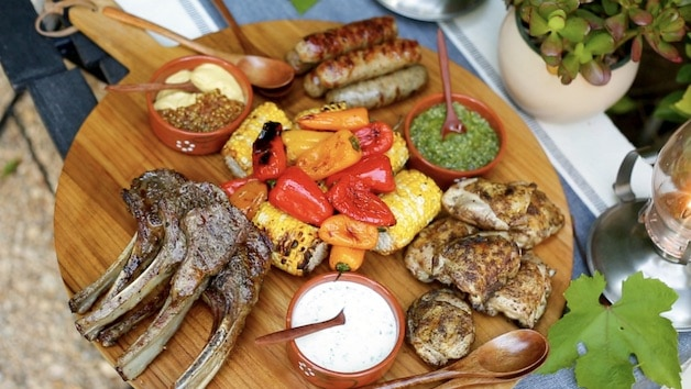 a board showing a mixed grill dinner
