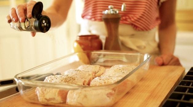 Adding Garam Masala to chicken thighs in Pyrex