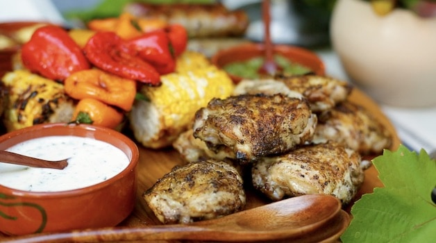Grilled chicken on a mixed grill platter