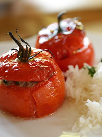 Stuffed Tomatoes on a plate with Rice