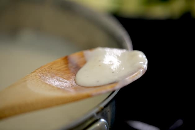 Bechamel Sauce on a wooden spoon