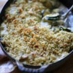 Vertical Image of baked zucchini with bread crumbs on top