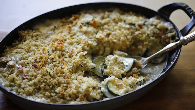 Zucchini Gratin with a spoon in the center for serving