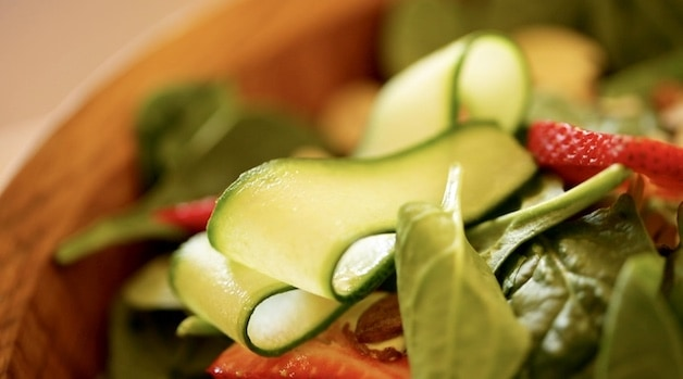 Sliced Cucumber Ribbons on a Bed of Spinach