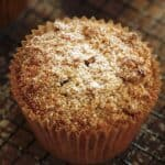 Vertical image of powdered sugar on a crumb muffin