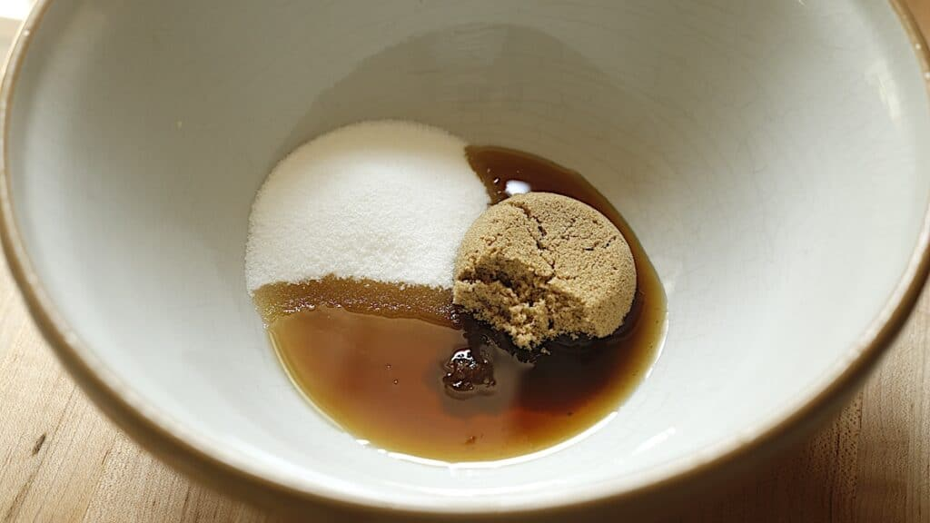 Bowl of white and brown sugar with maple syrup