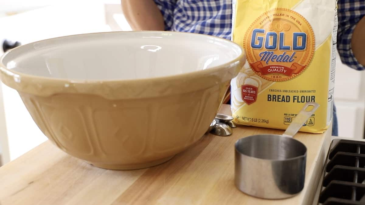 Bread flour and beige bowl with measuing cup