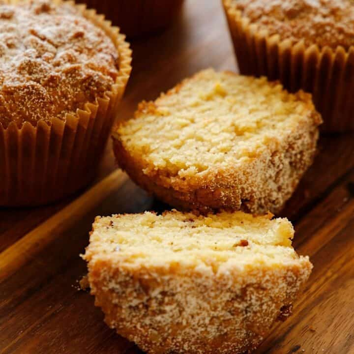 Orange Pecan Muffins sliced and whole on a cutting board