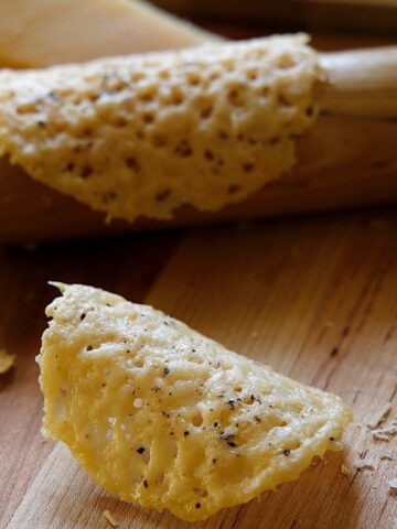 Parmesan Tulle on a board with rolling pin