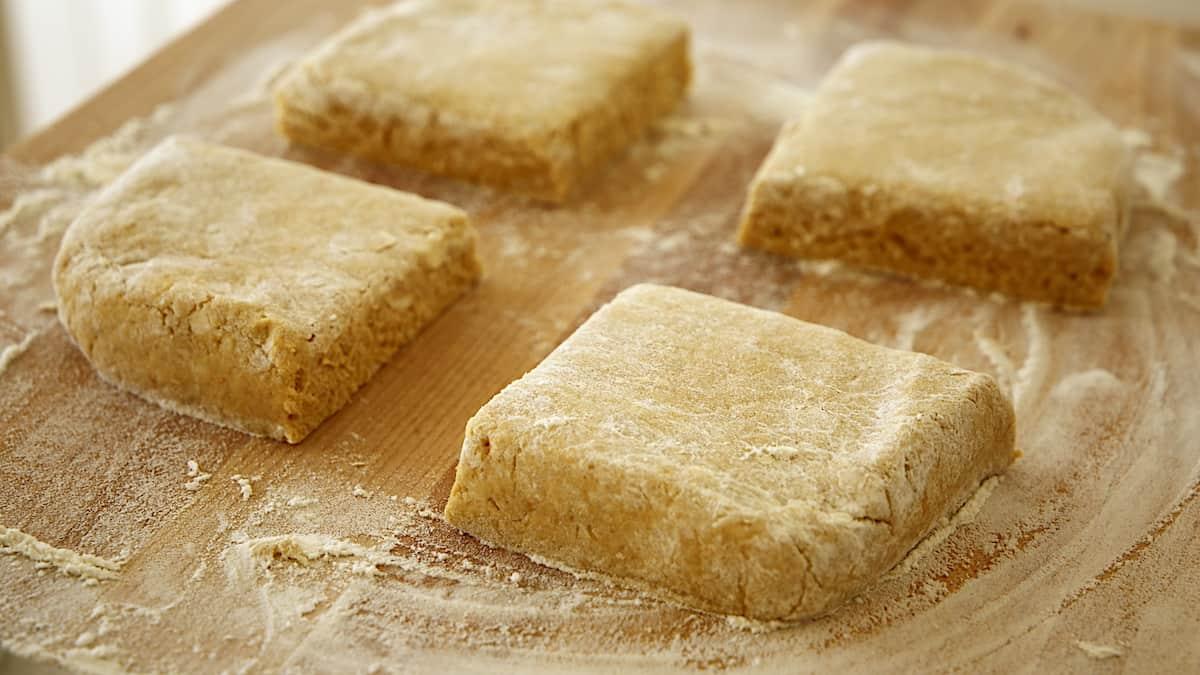 scone dough cut into 4 squares