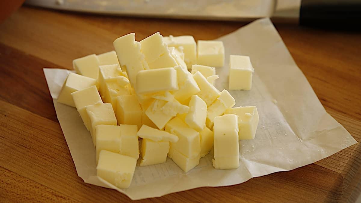 diced butter piled high on a butter wrapper
