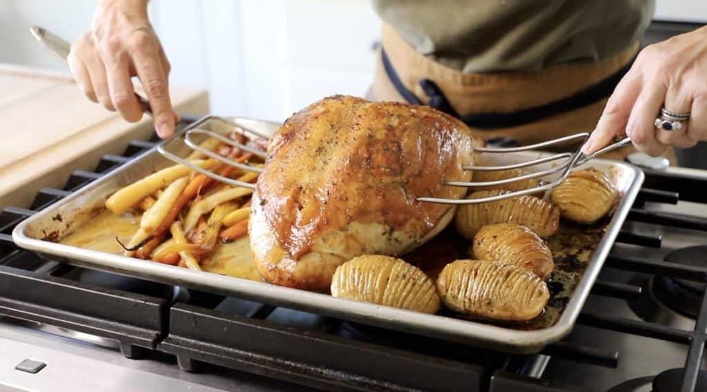 Turkey Forks lifting roasted Turkey off sheet pan