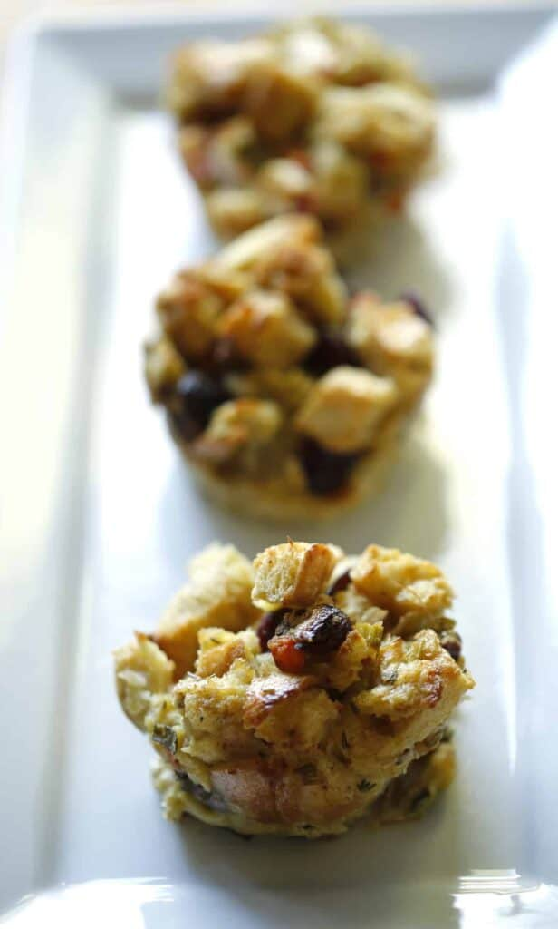 vertical image of Stuffing Muffins on a Rectangular white platter
