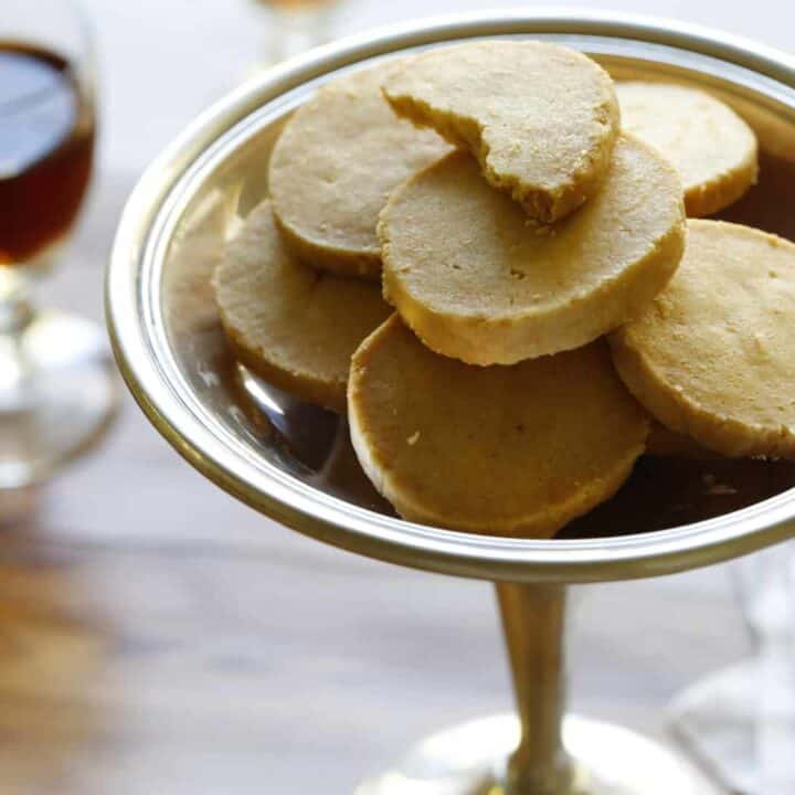 cheddar cheese crackers in a dish with port glasses