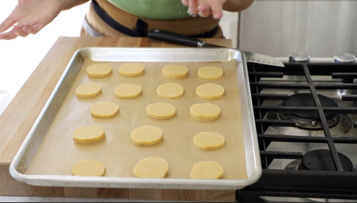 Sliced Cheddar Cheese Coin dough disks on cookie sheet