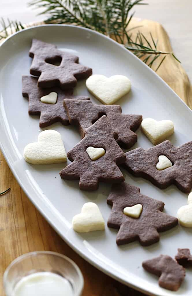 a platter of Christmas Tree Cookies with Sugar Cookie Hearts and a glass of milk
