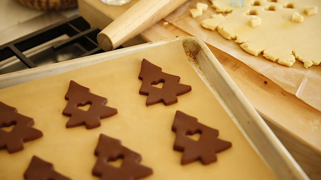 Chocolate Cut Cookies in the Shape of Christmas Trees on a Baking sheet