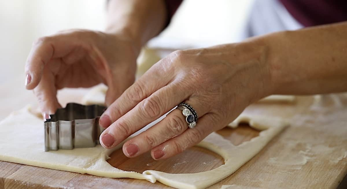 cutting out Christmas Trees in Puff Pastry Dough