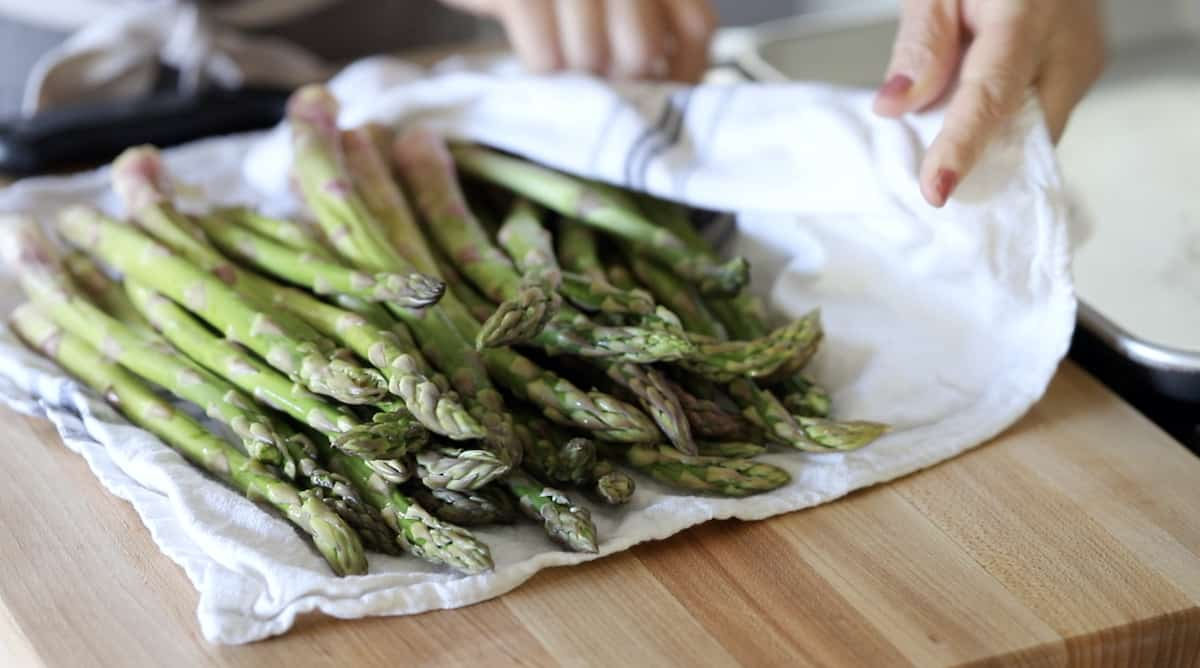 Asparagus drying on a dish towel