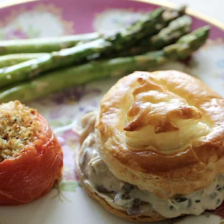 Bouchee a la Reine and Asparagus with a Stuffed Tomato on the plate