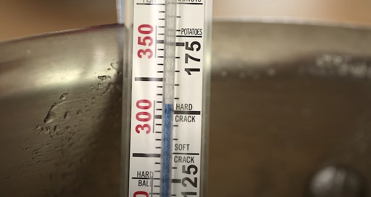 a candy thermometer registering at 302F for a hard crack