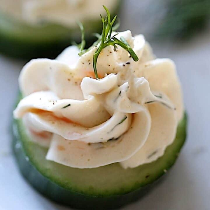 Salmon Mousse on Cucumber slices with dill garnish
