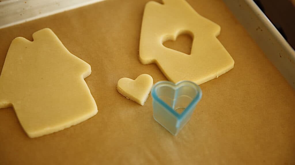 a sugar cookie house and heart cut out