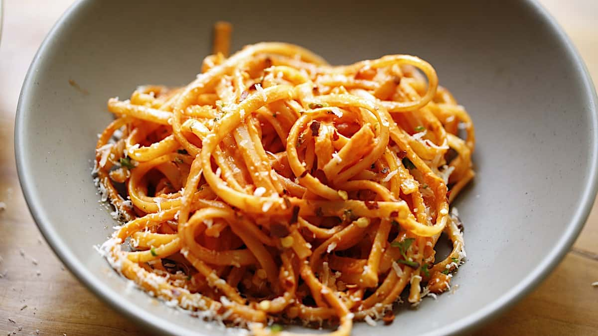 An individual serving of linguine tossed with a pink sauce