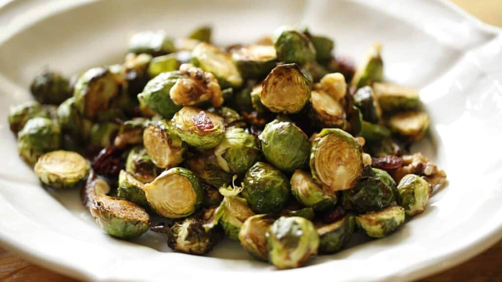 a white oval platter filled with Air Fryer Brussel Sprouts