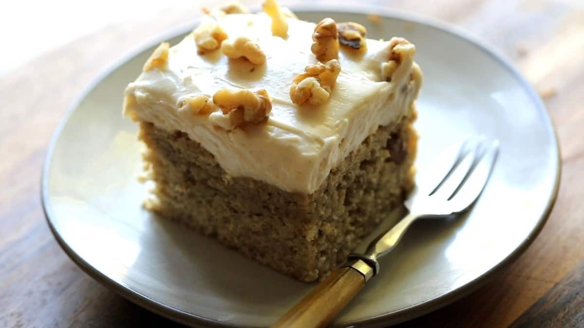 a slice of banana cake on a small plate with fork