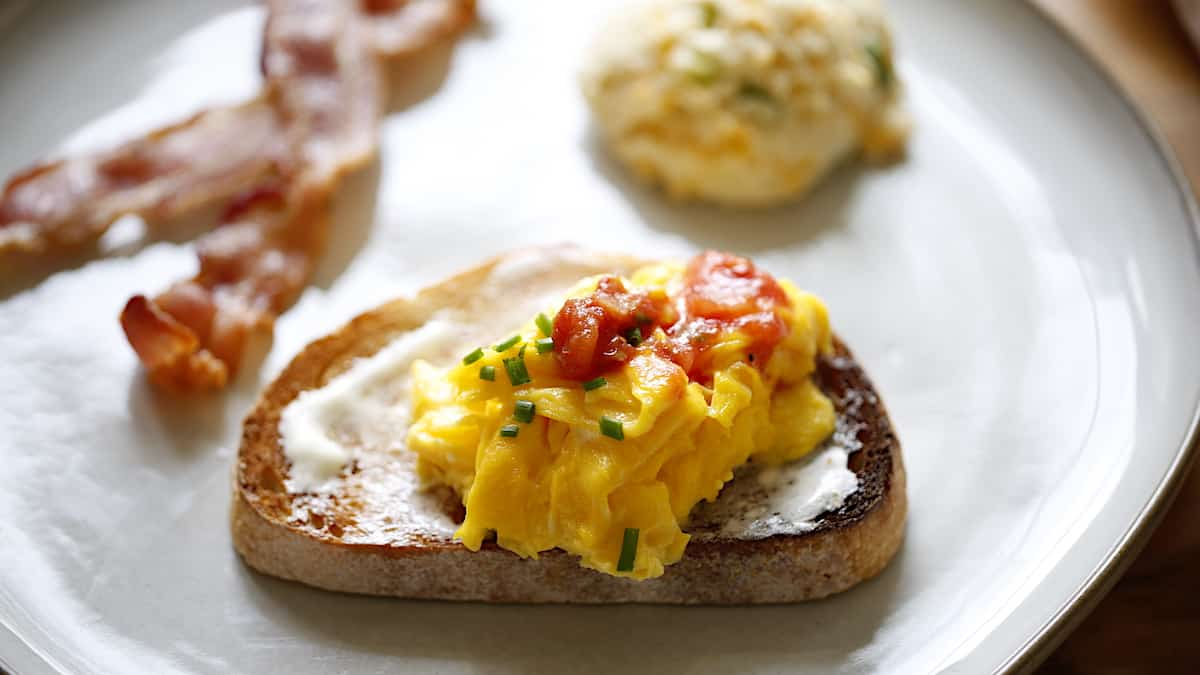 Scrambled eggs on toast of buttered toast with Salsa