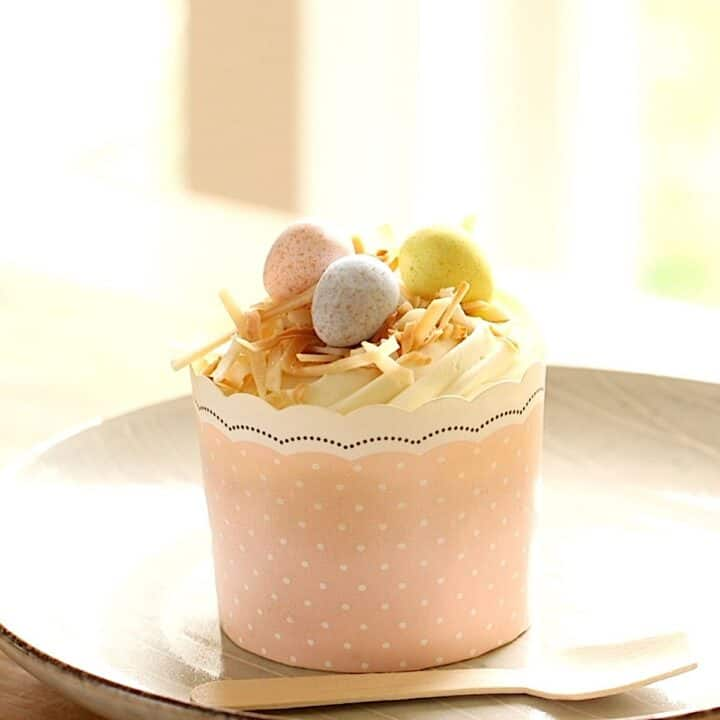 Easter Cupcakes in a Pink Liner with Chocolate eggs and shredded coconut on top