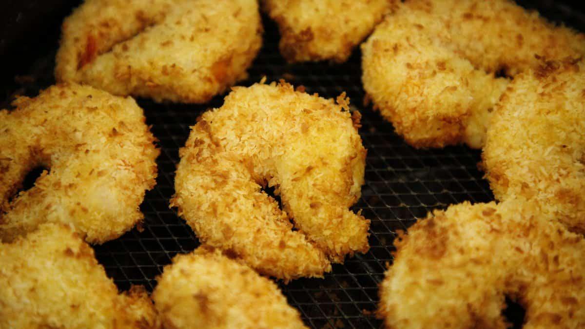 Air Fryer Coconut Shrimp in an air fryer basket