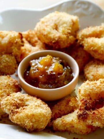 Air Fryer Coconut Shrimp on a platter with Mango Cutney