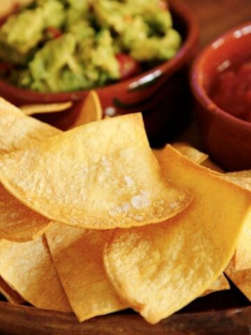 Air Fryer Tortilla Chips on a Platter with Salsa and Guacamole