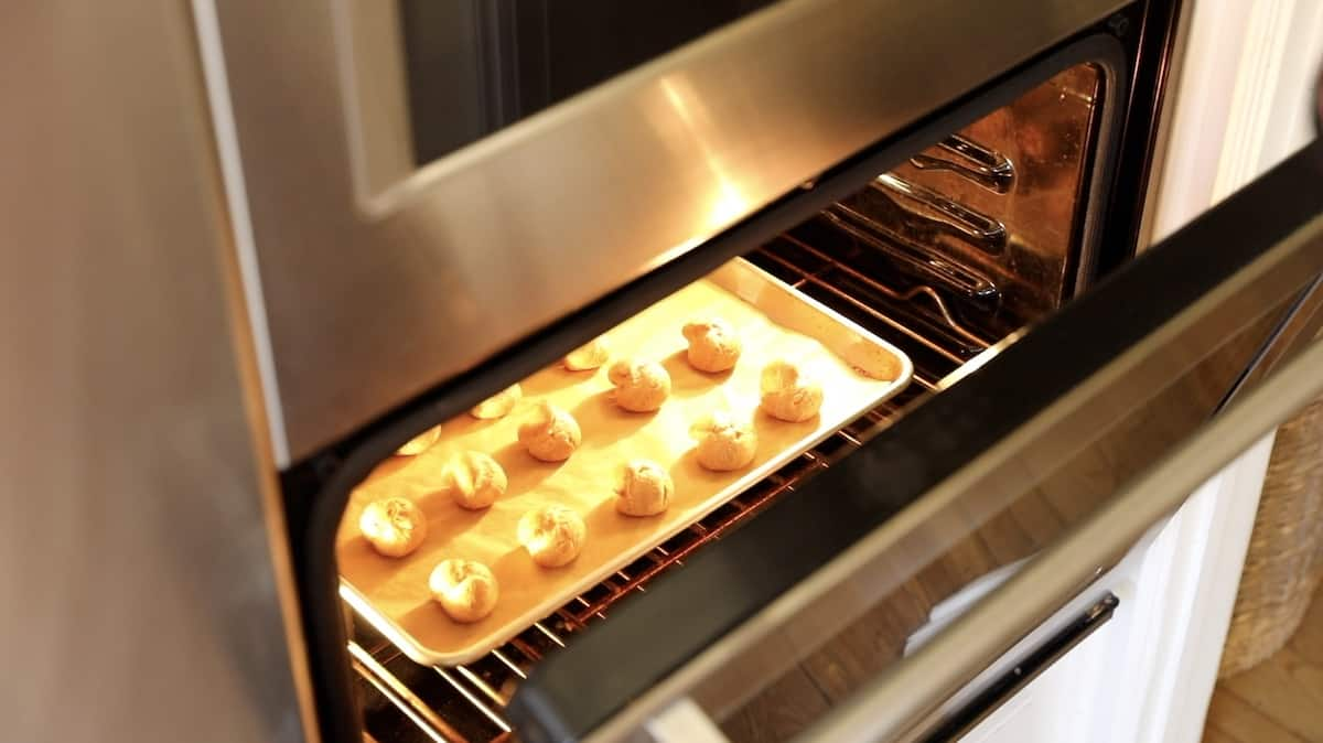 creme puffs cooling in the oven with the door left open