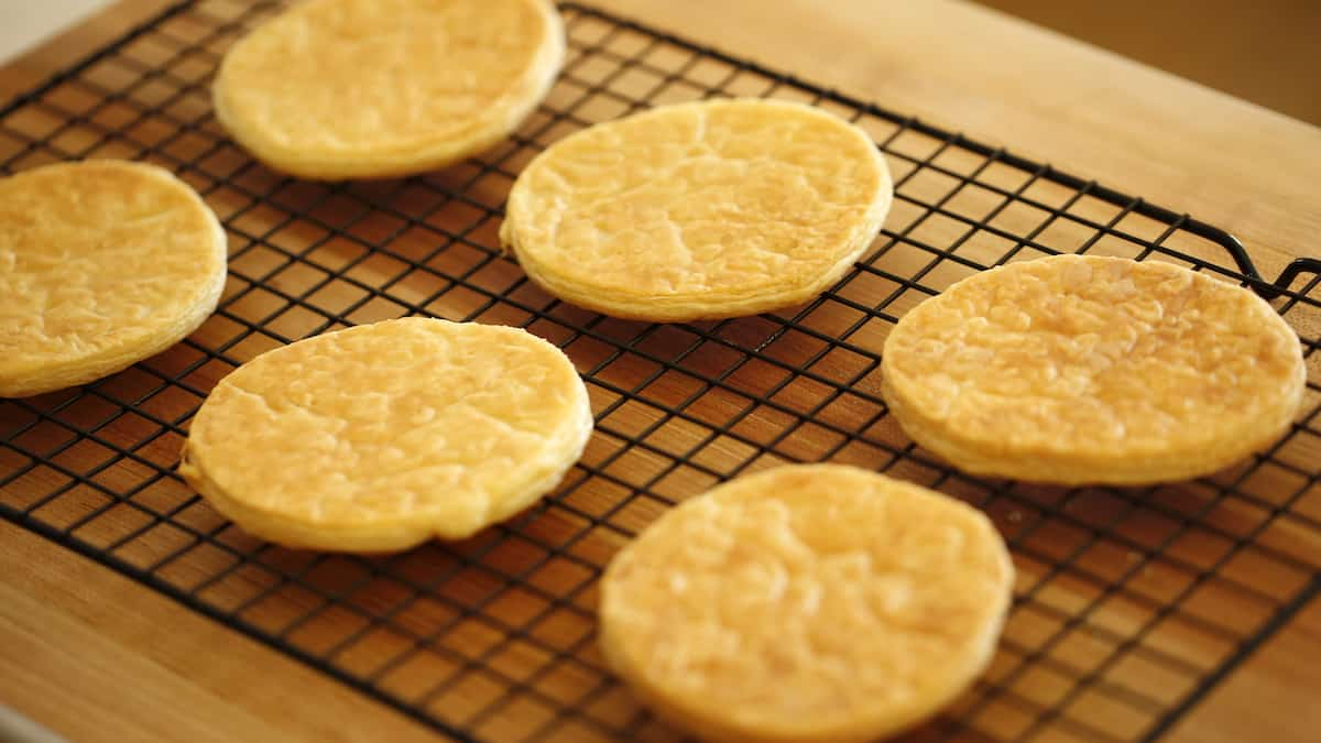 puff pastry rounds baked and cooling on a cookie rack