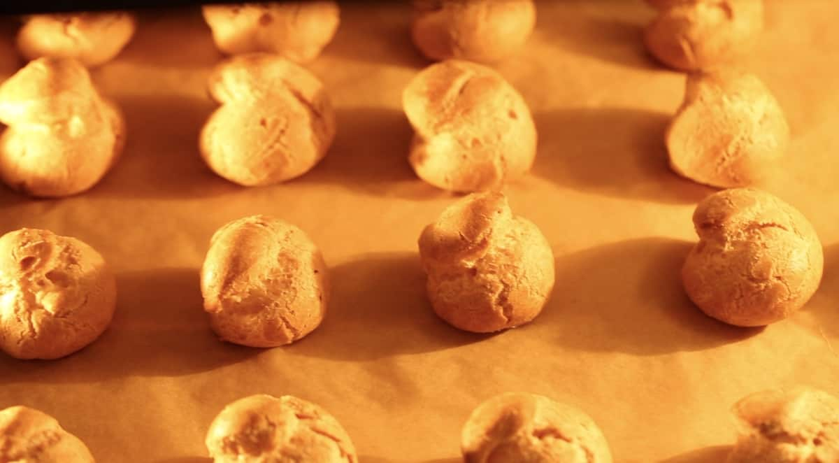 Cream puffs drying out in the oven as it cools down